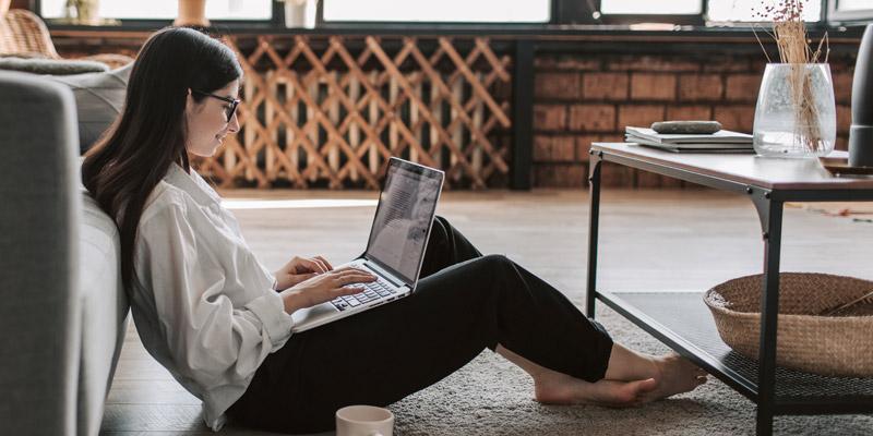 Woman sitting at computer taking panelbase surveys